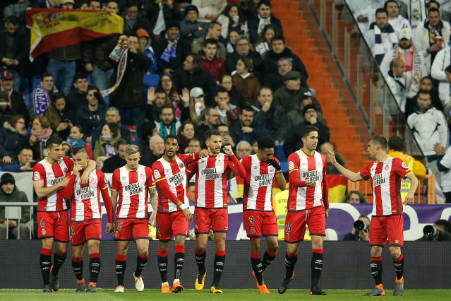 Girona's Cristina Ricardo Stuani, center, celebrates with teammates after scoring during a Spanish La Liga soccer match between Real Madrid and Girona at the Santiago Bernabeu stadium in Madrid, Spain, Sunday, March 18, 2018. (AP Photo/Paul White)