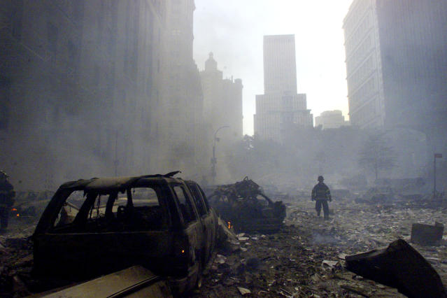 <p>A firefighter walks amid rubble near the base of the destroyed World Trade Center in New York on Sept. 11, 2001. (Photo: Peter Morgan/Reuters) </p>