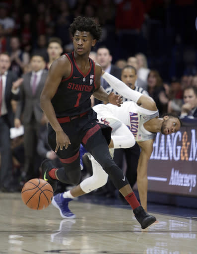 Stanford guard Daejon Davis (1) steals the ball from Arizona guard Parker Jackson-Cartwright during the first half during an NCAA college basketball game Thursday, March 1, 2018, in Tucson, Ariz. (AP Photo/Rick Scuteri)