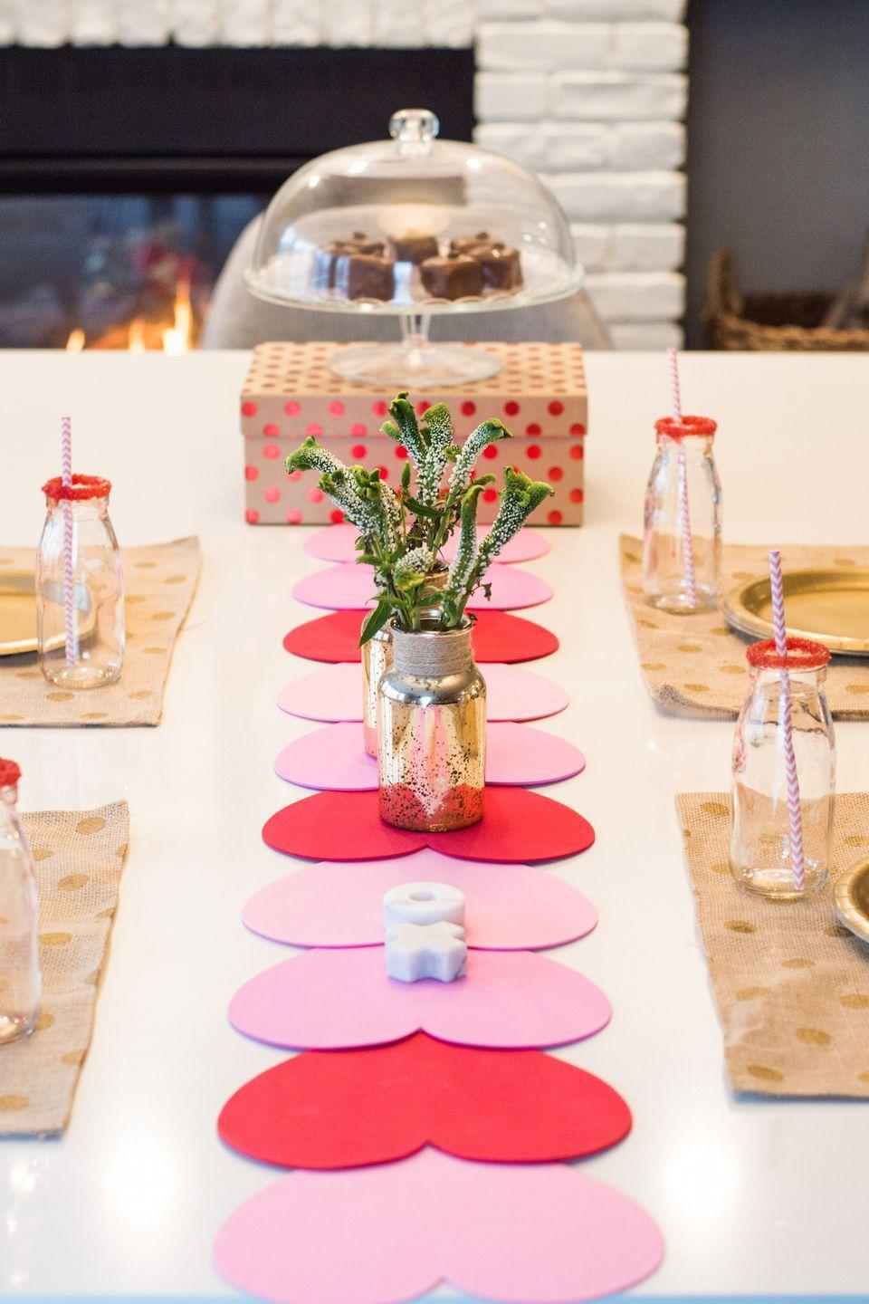 """<p>Give your Galentine's dinner table a little extra love with this sweet and simple runner, made with pre-cut hearts. </p><p><a href=""""https://www.anightowlblog.com/valentines-diy-table-runner/"""" rel=""""nofollow noopener"""" target=""""_blank"""" data-ylk=""""slk:Get the tutorial at A Night Owl »"""" class=""""link rapid-noclick-resp""""><em>Get the tutorial at A Night Owl »</em> </a></p>"""