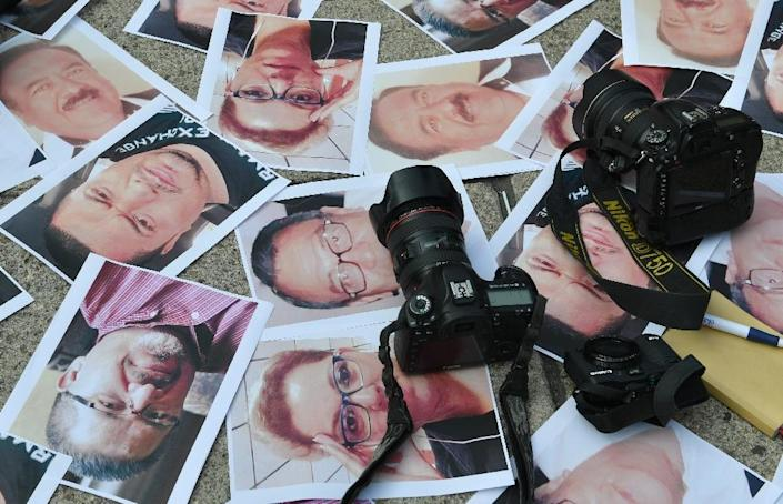 105 journalists have been murdered and a further 23 have disappeared since 2000, according to Articulo 19, a group that advocates for freedom of the press (AFP Photo/YURI CORTEZ)