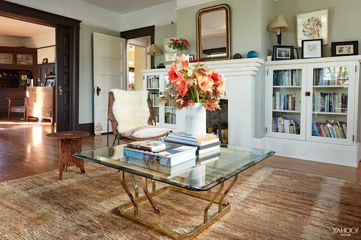 <p>The glass and metal coffee table from Casa Victoria in Silver Lake, the flowers came from my favorite florist, Holly Flora, and the mirror above the fireplace was brought back from France in our suitcase.</p>