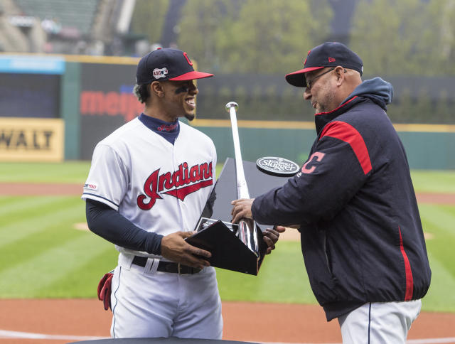 Cleveland Indians' Francisco Lindor, left, receives his 2018 Louisville Silver Slugger award from manager Terry Francona before a baseball game against the Seattle Mariners in Cleveland, Friday, May 3, 2019. (AP Photo/Phil Long)
