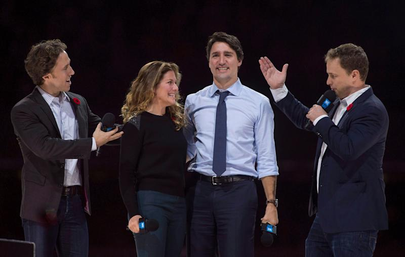 Craig (left) and Marc Kielburger introduce Prime Minister Justin Trudeau and his wife Sophie Gregoire-Trudeau as they appear at the WE Day celebrations in Ottawa on Nov. 10, 2015. (Photo: Adrian Wyld/CP)