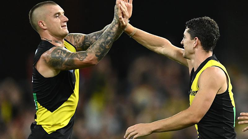 Richmond players, pictured here celebrating a goal against St Kilda in their AFL semi-final clash.