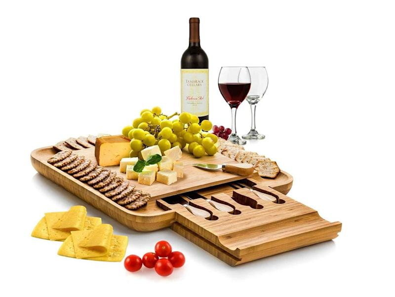 """Those nights in watching the baby monitor just got a whole lot more exciting with this fancy-ass cheese board set. Bonus if you also provide cheese and drinks. Get it at <a href=""""https://www.amazon.ca/dp/B01DTFF0Y8/ref=cm_gf_aAN_i0_i3_i6_d_p0_c0_qd0______________3lVgW9vglgYie09zMzKk"""" target=""""_blank"""" rel=""""noopener noreferrer"""">Amazon</a> for $64.99."""
