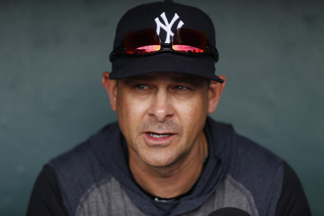 New York Yankees manager Aaron Boone is interviewed before a spring training baseball game against the Detroit Tigers, Thursday, March 5, 2020, in Lakeland, Fla. (AP Photo/Carlos Osorio)