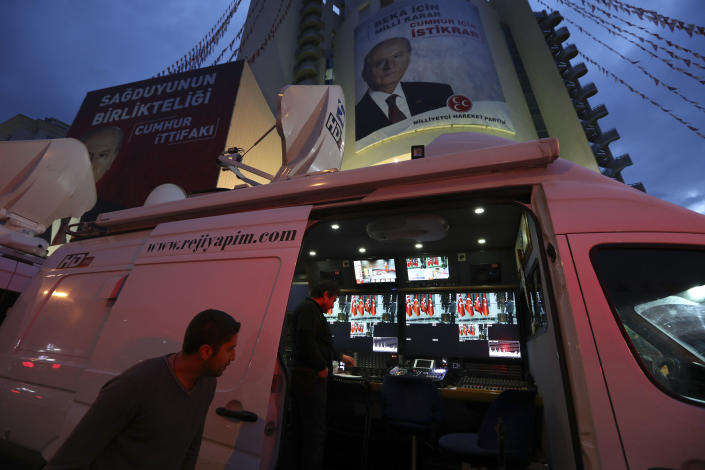A satellite truck with an editing station provides coverage of the local elections in Ankara, Turkey, Sunday, March 31, 2019. Millions of Turks have voted in municipal elections that President Recep Tayyip Erdogan depicted as a fight for Turkey's survival, and which are a crucial test of the strongman's own support amid a sharp economic downturn. The voting, which ended in the evening, has been marred by scattered election violence that killed at least two people and injured dozens of others across Turkey. (AP Photo/Ali Unal)