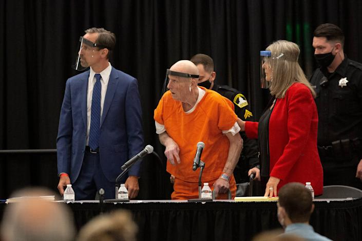 Joseph James DeAngelo, arrested in 2018 over crimes committed by the Golden State Killer, wears a face shield in a makeshift courtroom in a Sacramento State University ballroom June 29.