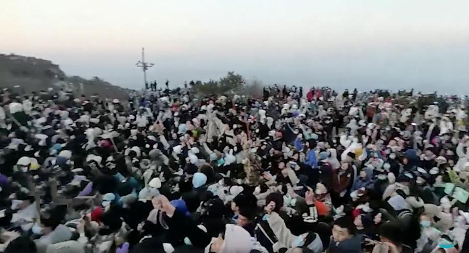 Another still showing hordes of tourists at Mount Tai at sunrise.