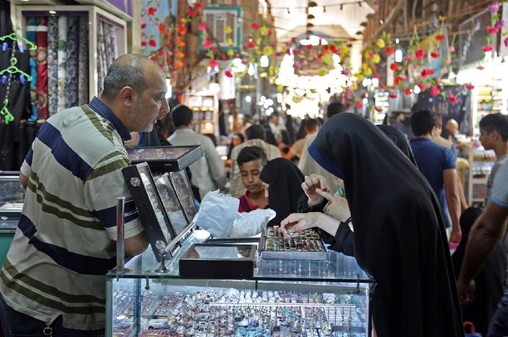 """The """"must-have"""" item is the Najaf quartz, a stone that looks like glass but is solid as rock and is found in the desert that encircles the city, says one trader (AFP Photo/)"""