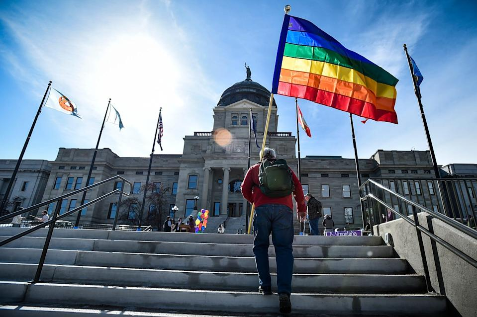 Demonstrators gather on the steps of the Montana State Capitol protesting proposed anti-transgender legislation.
