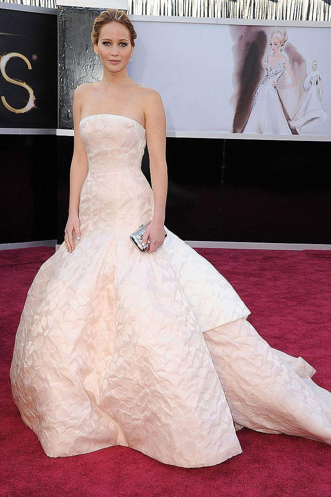"""<p>Lawrence looked stunning at the 2013 Oscars in a Dior Couture blush ball gown. She tripped while ascending the stairs to receive her award for Best Actress for her role in <em>Silver Linings Playbook</em>. She joked to <a href=""""http://www.vogue.co.uk/gallery/jennifer-lawrence-oscars-fall-dior-couture-dress-last-minute-fitting"""" rel=""""nofollow noopener"""" target=""""_blank"""" data-ylk=""""slk:Vogue"""" class=""""link rapid-noclick-resp"""">Vogue</a> in an interview, """"Was that on purpose? Absolutely.""""</p>"""