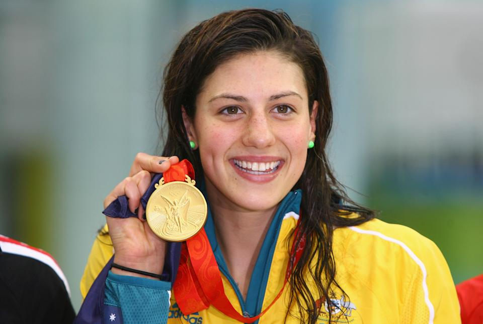 Stephanie Rice of Australia poses with the gold medal during the medal ceremony for the Women's 200m Individual Medley held at the National Aquatics Center on Day 5 of the Beijing 2008 Olympic Games on August 13, 2008 in Beijing, China. (Photo by Adam Pretty/Getty Images)
