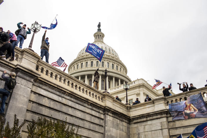 A pro-Trump mob climbs the Capitol building in Washington, Jan. 6, 2021. (Jason Andrew/The New York Times)