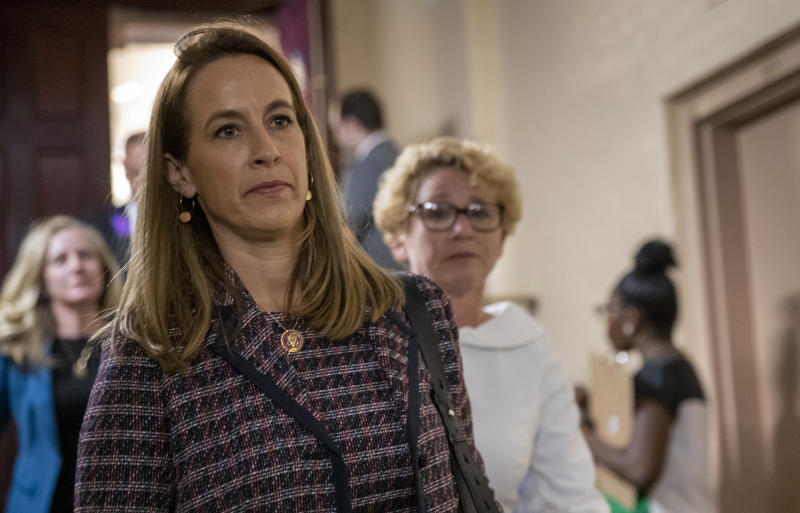 Rep. Mikie Sherrill, D-N.J., joined at right by Rep. Chrissy Houlahan, D-Pa., leave a House Democratic Caucus meeting with Speaker of the House Nancy Pelosi, D-Calif., where she was persuaded to launch a formal impeachment inquiry against President Donald Trump, at the Capitol in Washington, Tuesday, Sept. 24, 2019. Rep. Sherrill and Rep. Houlahan are two of several freshmen Democrats with national security backgrounds who wrote an op-ed letter to the Washington Post calling for Trump's impeachment. (AP Photo/J. Scott Applewhite)