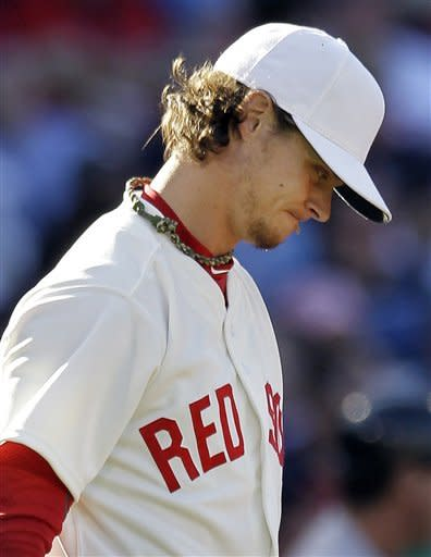 Boston Red Sox starting pitcher Clay Buchholz reacts after giving up a home run to New York Yankees' Alex Rodriguez in the fifth inning of a baseball game at Fenway Park in Boston, Friday, April 20, 2012. (AP Photo/Elise Amendola)