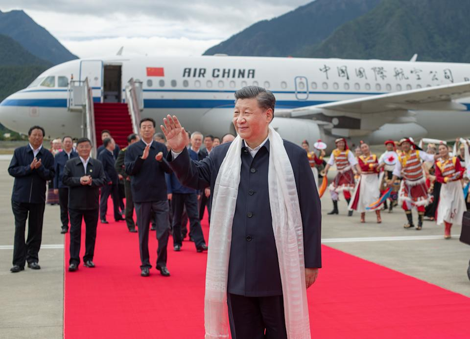 Chinese President Xi Jinping, also general secretary of the Communist Party of China CPC Central Committee and chairman of the Central Military Commission, arrives at the Nyingchi Mainling Airport and is warmly welcomed by local people and officials of various ethnic groups in southwest China's Tibet Autonomous Region, July 21, 2021. Xi visited the Tibet Autonomous Region from Wednesday to Friday. He extended congratulations to the 70th anniversary of Tibet's peaceful liberation and visited officials and ordinary people of various ethnic groups. (Photo by Xie Huanchi/Xinhua via Getty Images)