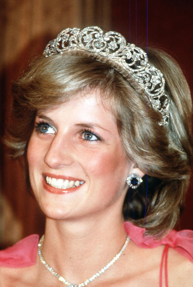 <p>The Spencer tiara is a family heirloom. The cherished possession was originally given to Princess Diana's grandmother, Lady Cynthia Hamilton, as a wedding gift back in 1919. In the '30s, the headpiece was adorned with tulip-shaped diamonds. The headpiece was worn by Diana's sisters on their wedding days, and by Victoria Lockwood, the first wife of Diana's brother, Charles. Of course, Diana decided to wear the family tiara on her wedding day too, despite being offered the Cambridge Lover's Knot tiara by Queen Elizabeth. Here, Princess Diana is pictured wearing the tiara at a state reception in Brisbane, Australia, in April 1983. </p>