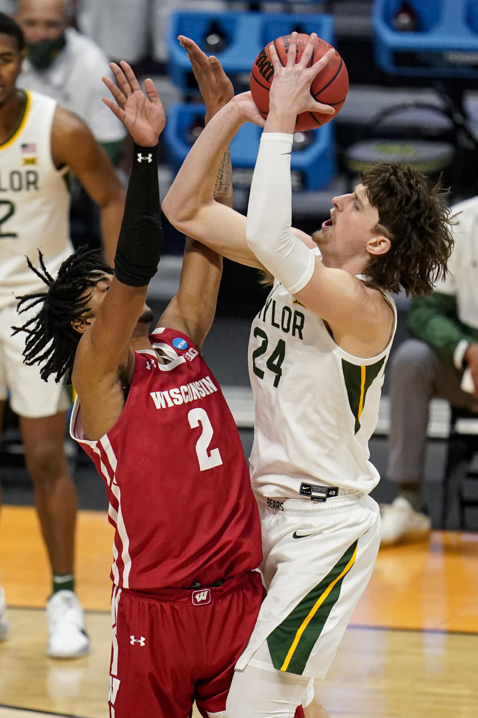 Baylor guard Matthew Mayer (24) shoots over Wisconsin forward Aleem Ford (2) in the second half of a second-round game in the NCAA men's college basketball tournament at Hinkle Fieldhouse in Indianapolis, Sunday, March 21, 2021. (AP Photo/Michael Conroy)