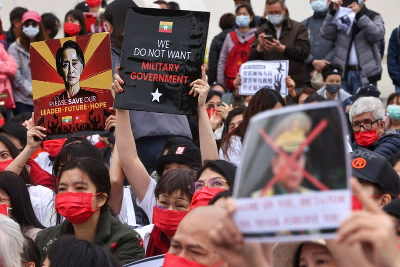 People gather to denounce the Myanmar military coup, in Taipei