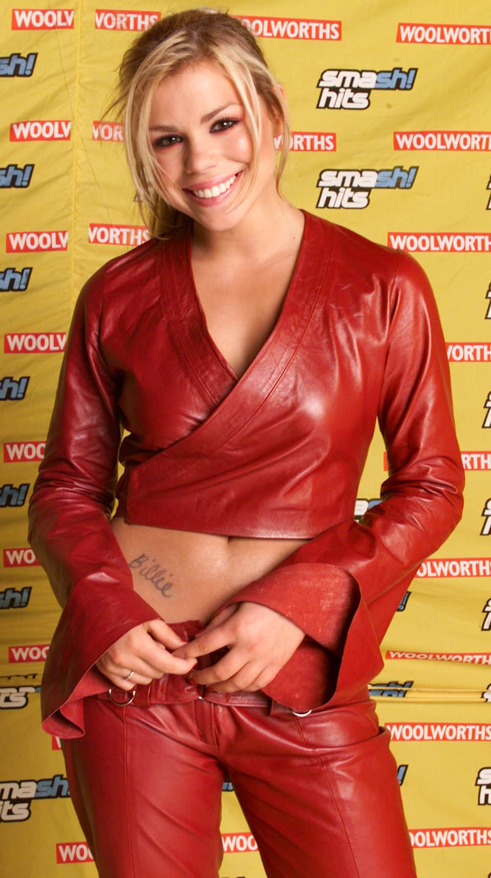LONDON - DECEMBER 9: British pop star Billie Piper poses backstage after performing at the Smash Hits Poll Winners Party held at the London Docklands Arena on December 9, 2001 in London. (Photo by Dave Hogan/Getty Images)