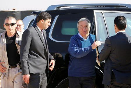 United Nations Secretary General Antonio Guterres (2nd R) exists a car during his visit to Al Zaatari refugee camp in the Jordanian city of Mafraq, near the border with Syria