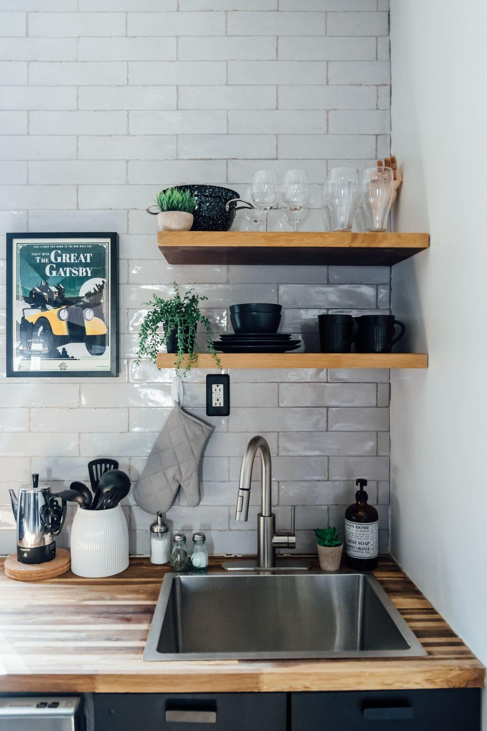 "<p>By adding extra shelves <em>($16, </em><a href=""https://www.amazon.com/Command-Picture-1-Ledge-10-Medium-HOM21S-ES/dp/B01C60CA8Q/"" rel=""nofollow noopener"" target=""_blank"" data-ylk=""slk:amazon.com"" class=""link rapid-noclick-resp""><em>amazon.com</em></a>) for dinnerware, <a href=""https://www.housebeautiful.com/design-inspiration/house-tours/a34609201/shari-francis-jersey-city-home-tour/"" rel=""nofollow noopener"" target=""_blank"" data-ylk=""slk:Shari Francis"" class=""link rapid-noclick-resp"">Shari Francis </a>turns a previously wasted wall into a handy storage spot for dinnertime favorites.</p>"