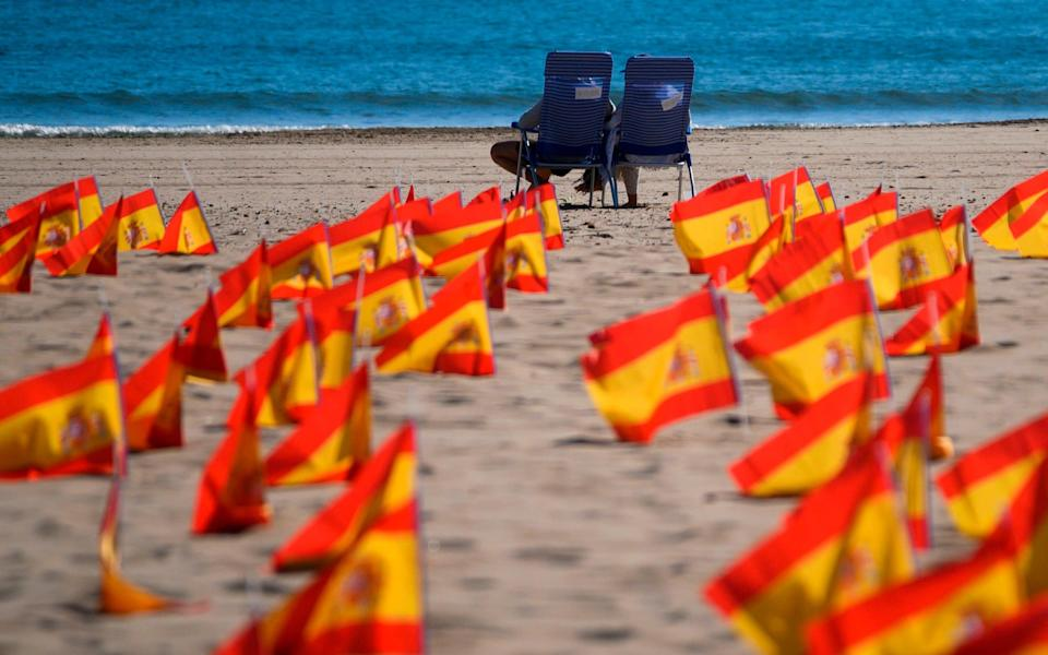 Thousands of Spanish flags, representing the Spanish victims of COVID-19, are pictured on Patacona beach in Valencia - Getty