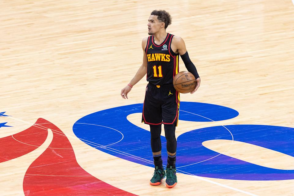 Atlanta Hawks guard Trae Young (11) dribbles the ball at center court against the Philadelphia 76ers.