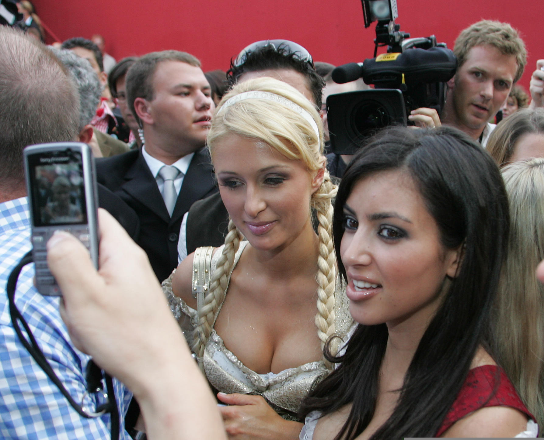 U.S. socialite Paris Hilton, left, walks with her friend Kim Kardashian through the crowd at the Oktoberfest beer festival in Munich, southern Germany, Monday, Sept. 25, 2006. The 25-year-old American socialite, sometime screen siren and budding songstress, showed off a golden dirndl-inspired creation in this Bavarian city famous for its beer drinking and its annual Oktoberfest, which began Sept. 16. (AP Photo/Diether Endlicher)