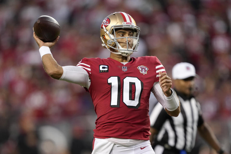 San Francisco 49ers quarterback Jimmy Garoppolo (10) passes against the Green Bay Packers during the first half of an NFL football game in Santa Clara, Calif., Sunday, Sept. 26, 2021. (AP Photo/Tony Avelar)