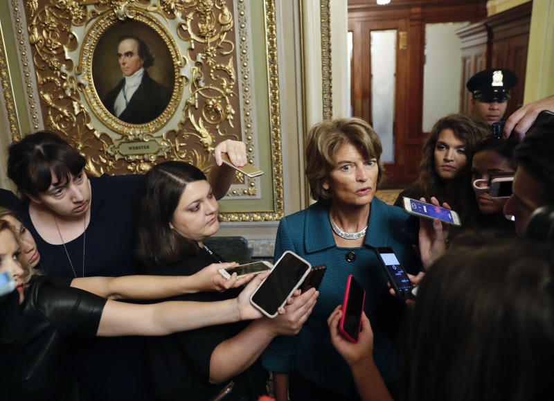 File - In this Oct. 4, 2018 file photo, Sen. Lisa Murkowski, R-Alaska, speaks to members of the media after a vote to advance Brett Kavanaugh's nomination to the Supreme Court, on Capitol Hill. Alaska Republican party leaders plan to consider whether to reprimand Murkowski for opposing Kavanaugh's confirmation. The party has asked Murkowski to provide any information she might want its state central committee to consider. Murkowski told reporters that if she worried about political repercussions she wouldn't be able to do the job Alaskans expect her to do. (AP Photo/Pablo Martinez Monsivais, File)