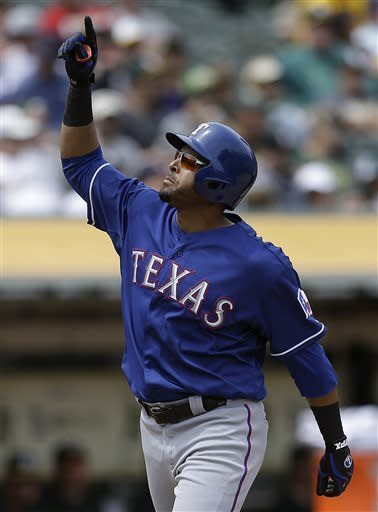 Texas Rangers' Nelson Cruz celebrates after hitting a three-run home run off Oakland Athletics' Jesse Chavez in the fifth inning of a baseball game on Wednesday, May 15, 2013, in Oakland, Calif. (AP Photo/Ben Margot)