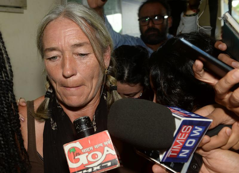 Fiona MacKeown, the mother of murdered British schoolgirl Scarlett Keeling, is surrounded by media as she leaves the Childrens Court in Panaji on September 23, 2016. A court in India cleared two men September 23 accused of the rape and homicide of 15-year-old British schoolgirl Scarlett Keeling whose bruised and semi-nude body was found on a Goa beach eight years ago. Friends and relatives of the two accused, Samson D'Souza and Placido Carvalho, cheered as the verdict was read out in the state capital Panaji. / AFP / INDRANIL MUKHERJEE (Photo credit should read INDRANIL MUKHERJEE/AFP/Getty Images)
