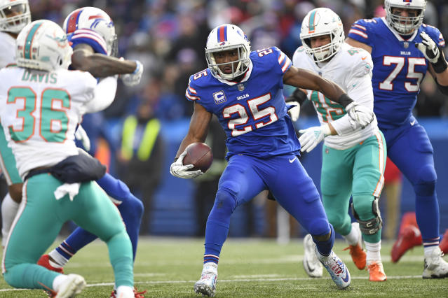 FILE - In this Dec. 30, 2018, file photo, then-Buffalo Bills running back LeSean McCoy (25) rushes for a 9-yard touchdown during the second half of an NFL football game against the Miami Dolphins in Orchard Park, N.Y. The Kansas City Chiefs announced the signing of two-time All-Pro running back LeSean McCoy on Monday, Sept. 2, 2019, two days after he was released by Buffalo. (AP Photo/Adrian Kraus, File)
