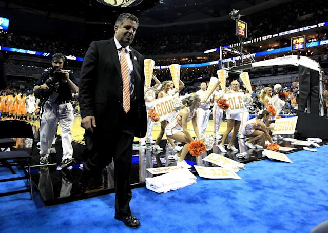 CHARLOTTE, NC - MARCH 18: Head coach Bruce Pearl of the Tennessee Volunteers walks off the court after the Volunteers were defeated 75-45 by the Michigan Wolverines during the second round of the 2011 NCAA men's basketball tournament at Time Warner Cable Arena on March 18, 2011 in Charlotte, North Carolina. (Photo by Streeter Lecka/Getty Images)