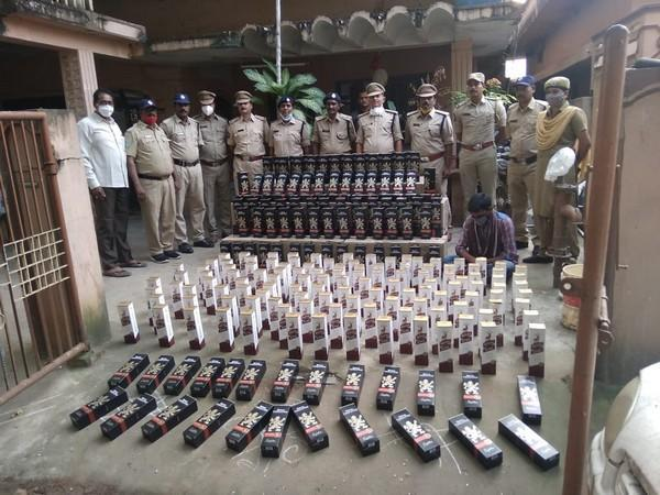 Andhra Police arrested a man for smuggling liquor into state. Photo/ANI