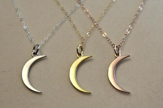 "<p>Forget playing Santa — be Jack Pearson this holiday season! Like the dreamy dad from <em>This Is Us</em>, bestow this delicate moon-shaped necklace on the love of your life. It comes in gold, rose gold, or silver. The three adorable kids come separately.<br><strong>Buy: <a href=""https://www.etsy.com/listing/514043116/this-is-us-moon-necklace-mandy-moore?gpla=1&gao=1&&utm_source=google&utm_medium=cpc&utm_campaign=shopping_us_b-jewelry-necklaces-other&utm_custom1=f4f045dd-a619-4553-8066-a5e48577a31f&gclid=EAIaIQobChMIyb3Dgdff1gIVQh2BCh3K-g7-EAkYByABEgJwrvD_BwE&source=aw&utm_source=affiliate_window&utm_medium=affiliate&utm_campaign=us_location_buyer&awc=6220_1510608311_b28bcc55e54d468783ffb83de7ecdfc5&utm_content=202819"" rel=""nofollow noopener"" target=""_blank"" data-ylk=""slk:Etsy/JWhiz"" class=""link rapid-noclick-resp"">Etsy/JWhiz</a></strong> </p>"