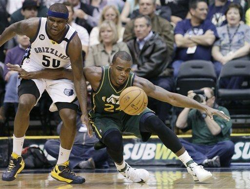 Memphis Grizzlies' Zach Randolph (50) and Utah Jazz's Paul Millsap (24) chase a loose ball in the second quarter during an NBA basketball game Saturday, March 16, 2013, in Salt Lake City. (AP Photo/Rick Bowmer)