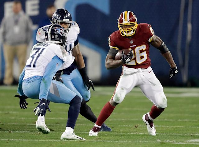 Washington Redskins running back Adrian Peterson (26) carries the ball against Tennessee Titans free safety Kevin Byard (31) in the second half of an NFL football game Saturday, Dec. 22, 2018, in Nashville, Tenn. (AP Photo/James Kenney)