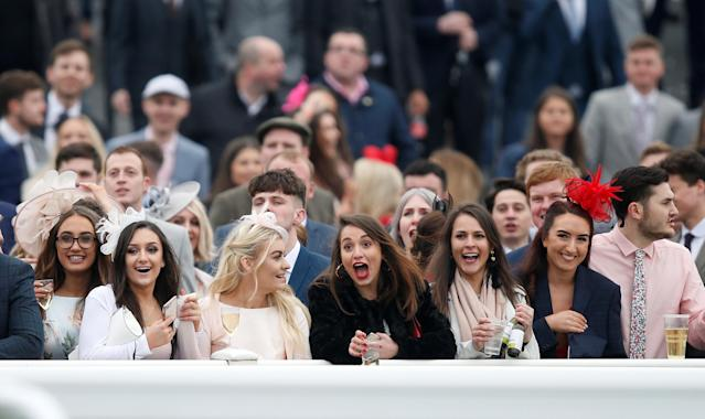 Horse Racing - Grand National Festival - Aintree Racecourse, Liverpool, Britain - April 13, 2018 Racegoers during Ladies Day at the Grand National Festival REUTERS/Andrew Yates