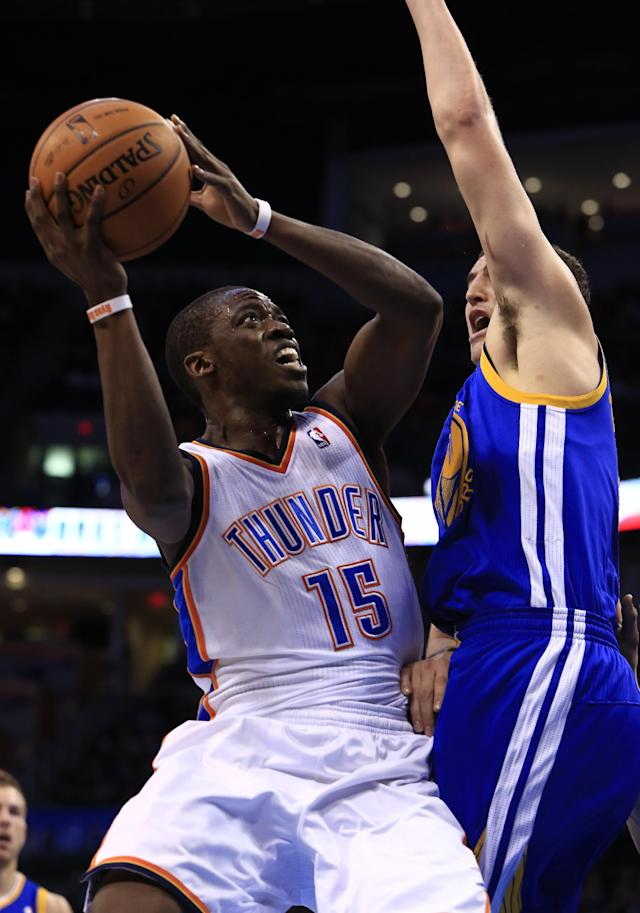 Oklahoma City Thunder point guard Reggie Jackson (15) shoots as Golden State Warriors shooting guard Klay Thompson (11) defends during the third quarter of an NBA basketball game Friday, Jan. 17, 2014, in Oklahoma City. (AP Photo/Alonzo Adams)