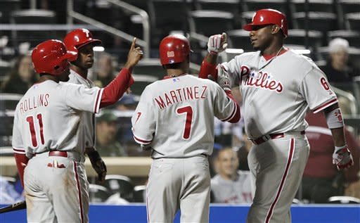 Philadelphia Phillies' Ryan Howard (6) celebrates with teammates Michael Martinez (7), Jimmy Rollins (11), and Juan Pierre (10) after hitting a grand slam during the ninth inning of a baseball game against the New York Mets on Thursday, Sept. 20, 2012, in New York. The Phillies won 16-1. (AP Photo/Frank Franklin II)
