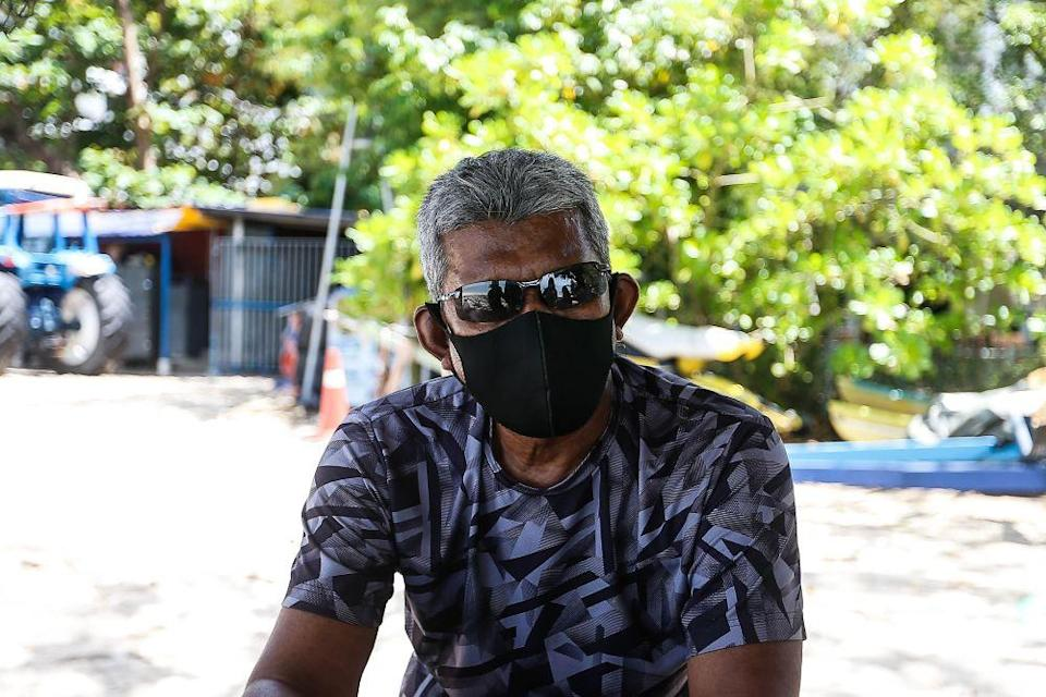 Man Dali, operator of Batu Feringghi Watersports, speaks to Malay Mail during an interview October 11, 2021. — Picture by Sayuti Zainudin