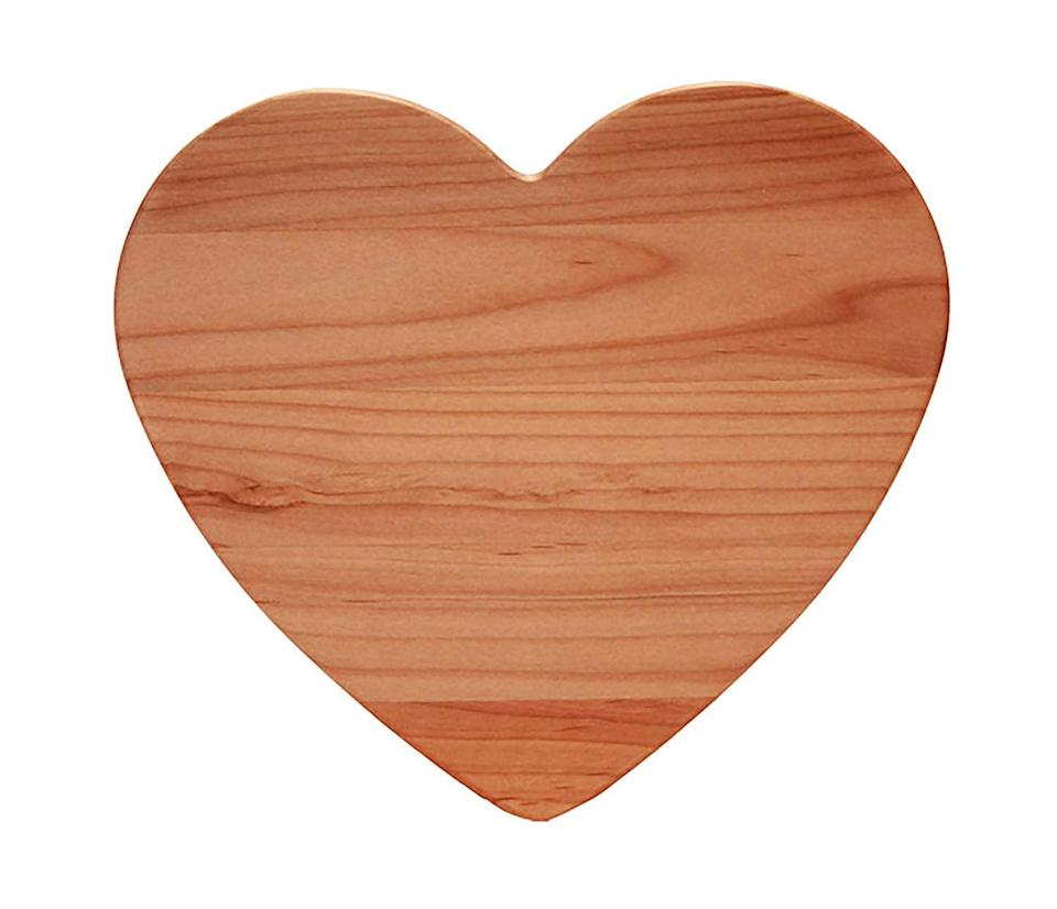 <p>Dice up food on this sweet <span>Out of the Woods of Oregon Heart 11-by-11-Inch Cutting Board</span> ($25).</p>