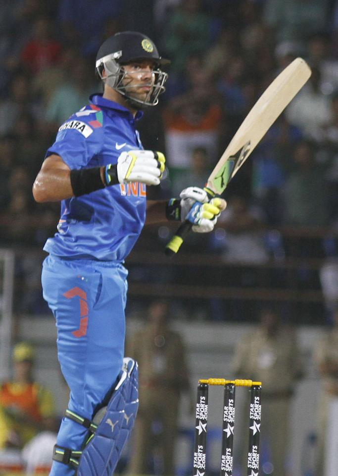 Indian batsman Yuvraj Singh plays a shot during T20 match between India and Austrilia at Rajkot 10 october 2013. (Photo: IANS)