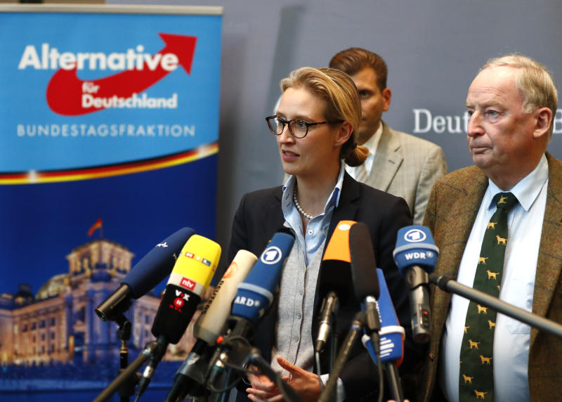 Anti-immigration AfD party top candidates Alice Weidel and Alexander Gauland make a statement after their first parliamentary meeting in Berlin on Tuesday.  (Fabrizio Bensch / Reuters)