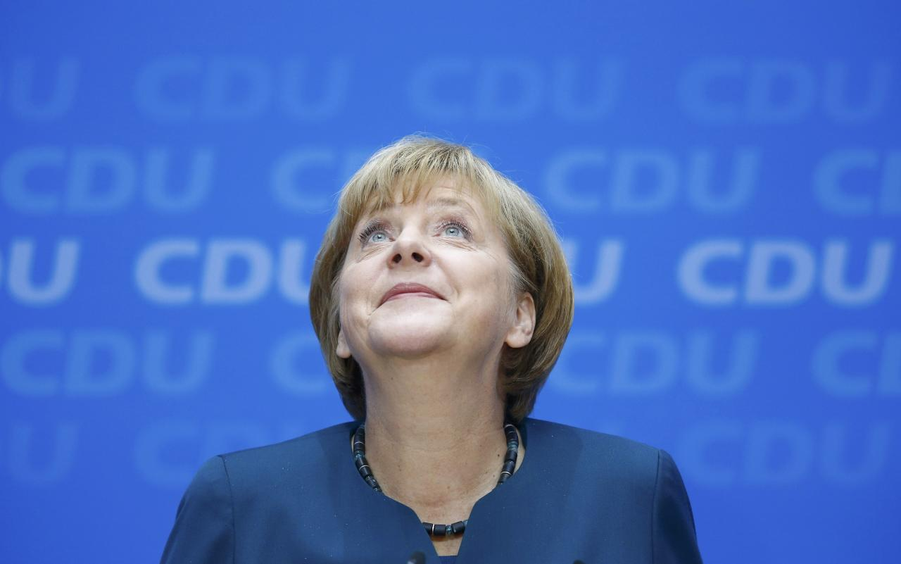German Chancellor and leader of the Christian Democratic Union ( CDU) Angela Merkel, smiles during a news conference after a CDU party board meeting in Berlin September 23, 2013, the day after the general election. Merkel faces the daunting prospect of persuading her centre-left rivals to keep her in power after her conservatives notched up their best election result in more than two decades but fell short of an absolute majority. REUTERS/Kai Pfaffenbach (GERMANY - Tags: POLITICS ELECTIONS HEADSHOT TPX IMAGES OF THE DAY)