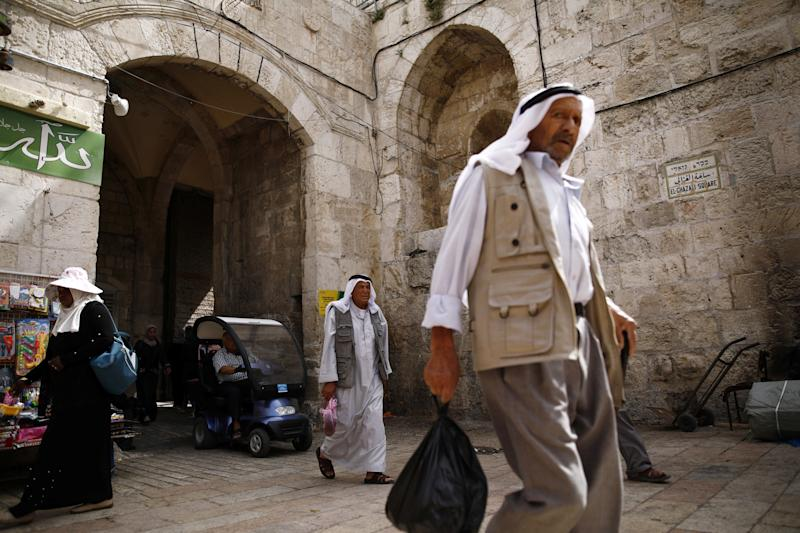 Palestinians walk through Herod's Gate in Jerusalem's Old City. (Photo: Nir Elias/Reuters)